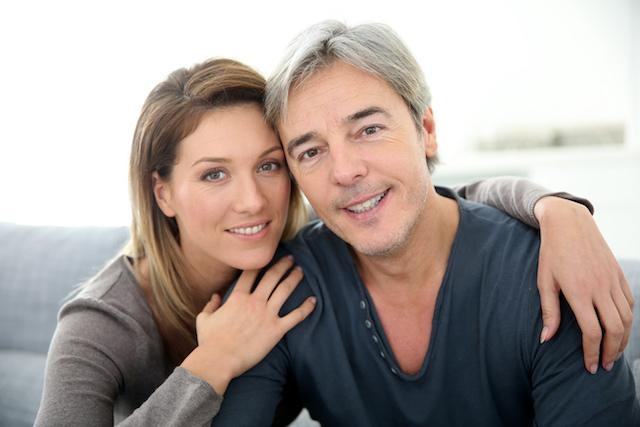 Husband and wife wearing dental bridges in 85022