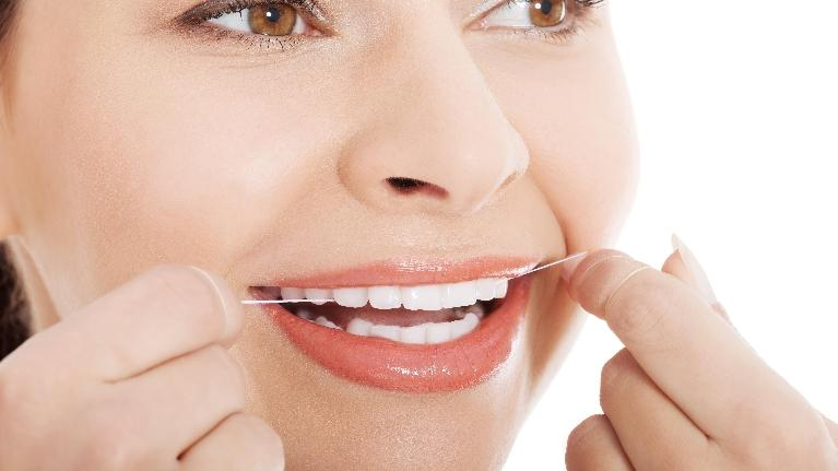 flossing routine | woman flossing | phoenix az dentist