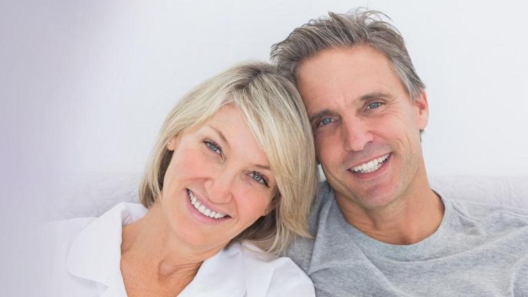 Couple smiling together | Dentures in Phoenix AZ